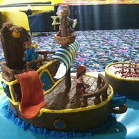 Jake And The Neverland Pirates Cake  German Chocolate cake covered in chocolate buttercream icing, details in regular buttercream and gum paste accents. Jake, Izzy and '...