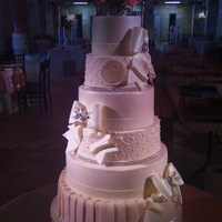 Wedding Bling Buttercream with fondant skirting, ribbon and bows. Top and bottom tiers are strawberry, the rest WASC.