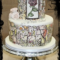 Beauty N Beast Stained Glass wedding cake. carrot cake with cream cheese b/c