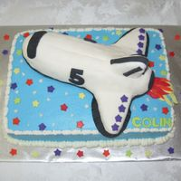 Space Shuttle This cake was for a little boy who loved space. I saw one on this site that gave me the ideasfor it. I made the shuttle out of ricekrispie...