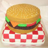 Cheeseburger On Picnic Table Covered in buttercream used cake ball mixture for meat. Cheese is fondant and checkeredsquares on table fondant.
