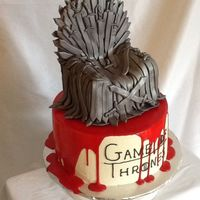 Game Of Thrones Fondant/gumpaste topper on vanilla cake. Poured red candy on top (I used red candy melts and whipping cream).