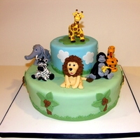 Safari Cake Raspberry swirl cake with chocolate buttercream filling. Characters are fondant.