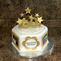 60Th Birthday Dark Chocolate with strawberry buttercream. Decorations are fondant & edible images