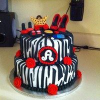 Zebra Cake Cake is just covered in buttercream with fondant accents. I made it for a girl at work, I hope she likes it.
