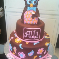 Paisley Graduation Cake 10, 6 in round covered in chocolate fondant. Owl shaped out of rk.