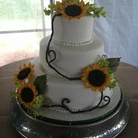 This Was A 14 10 6 With Gumpaste Sunflowers And Hydrangeas This was a 14, 10, 6 with gumpaste sunflowers and hydrangeas.