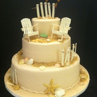 Beach Theme Retirement Cake 14,10,6 in. round, fondant covered. Gumpaste shells, fence, and chairs.