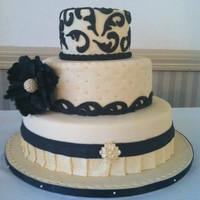 Black And Ivory Scroll Wedding Cake 14, 10,6 rd all covered in fondant. Silicone scroll molds were used.