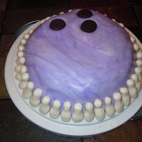 Bowling Ball Cake My son had a bowling party so I made a bowling ball with tiny pins all around it. The cake is covered in swirled fondant and the pins are...