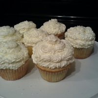 White Cupcakes White Cake with White buttercream icing. I made these for a couple who I did their wedding cake last year, to replace their topper cake.