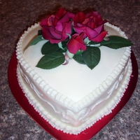 Single Tier Wedding Cake Silk flowers, buttercream icing