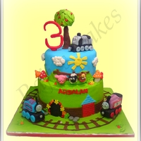 Train Cake Train theme cake All the trains and tree are made from Rice Krispy treat.Animals, Mushrooms, Flowers and Number Three from Fondant.3 Trains...