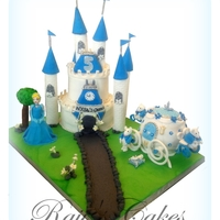 Cinderella Cake Cinderella cake!This the biggest project i ever done!Cinderella, Tree, clock tower and top tower with number 5 ,all made of Rice crispy...
