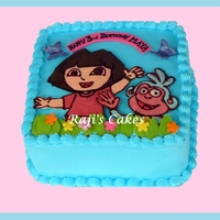 Dora Cake Dora and Boots are made from Chocolate Transfer. Fondant accents.Chocolate cake with chocolate Hazelnut Mousse!