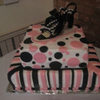 Designer Shoe Gum Paste shoe, on top of 2 tier cake . Fondant stripes and circle on Bettercream frosting