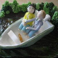 Grooms Cake The bride to be wanted me to make a cake for her hubby to be. He loves his boat on the lake in Vermont. Gum paste figures and boat. Finely...