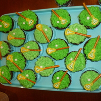 Jack's Lax Cupcakes fondant on top, buttercream netting, pretzel sticks for handle