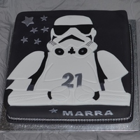 Storm Trooper 12 inch milk chocolate mudcake with chocolate buttercream and fondant. Storm trooper made from fondant.