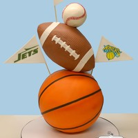 Sport Balls Cake The bottom half of the basketball and also the bottom third of the football were Styrofoam for support.