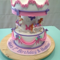 Carousel Cake Carousel cake made for a combined birthday and baptism. Couldn't fine 3d horses so had to make them myself.