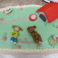 "Who's Teaching Who? White cake with French Vanilla buttercream. The figures are all made of fondant. The girl is ""teaching"" the dog to play dead. The..."