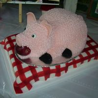 Pig Roast Cake I made this pig cake for the owner of a BBQ catering company. The Pig was done in flesh tone buttercream, with a fondant/gumpaste mixture...