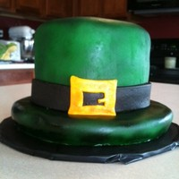St Patty's Hat Fondant covered chocolate cake, airbrushed with fondant accents.