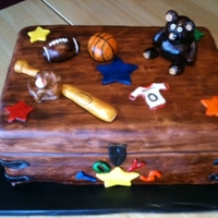 "Toy Box Cake This was made for a dad's baby shower. I wanted to make it more ""manly"". Toy box is three layers of cake, covered in MMF,..."