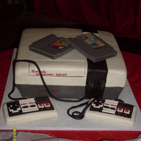 Nintendo Entertainment System choc cake w/buttercream covered in MMF. Controllers are rice krispie treats covered in MMF...games are real