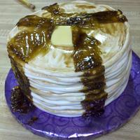 "Stack Of Pancakes Creamsicle cake and frosting with fondant ropes. Next time I'll make the ""syrup"" a lighter color! lol! Thanks for looking."