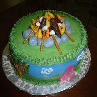 Camping I made this cake for my daughter's camping-themed birthday party. BC, with fondant tent and rocks for fire. Pretzels and mini...