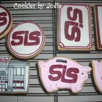Bank Cookies These are some cookies I did for one of the local banks. I had to do 80 of the circles and 40 of the banks-very tedious! NF with royal.