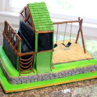 Playset Choc. chip fudge cake with raspberry chambord filling - covered in fondant, decor is fondant and gumpaste, sand is ground up animal...