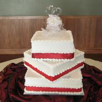 Red Ribbon Wedding *White cake, with buttercreme icing with Red ribbon.