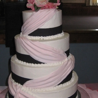 Lite Pink Swag Wedding Cake Italian creme buttercreme with fondant swags 4 tier wedding cake