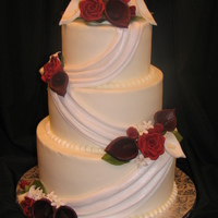 Calla Lilies And Roses Wedding I made the flowers on this cake to match the bride's bouquet. It's white cake with raspberry mousse filling and lemon cake with...