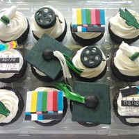 Film School Graduation Cupcakes   Chocolate cupcakes with gp/cc toppers.