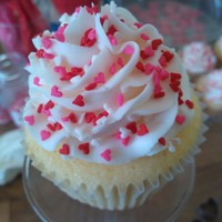 Valentine's Day Cupcakes Vanilla cupcakes with vanilla bc and heart sprinkles