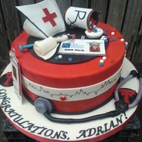 Er Nursing School Graduation WASC with chocolate ganache and mix of Duff's fondant and CC. GP and fondant details.