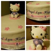 Hello Kitty Cake Ver 1 fondant covered cake with gumpaste hello kitty decorations. used the fmm tap it for the gumpaste letters