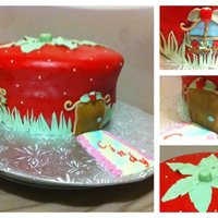 Strawberry Shortcake House semi sculpted cake. fondant covered with gumpaste decorations