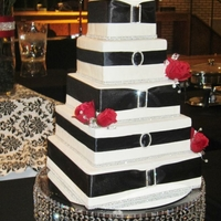 Classic Black, White And Red This bride was on a tight budget but she wanted this beautiful - LARGE cake. She WON her wedding (sans cake) in a contest so I decided what...