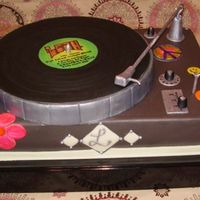 Leah's Turntable High School grad who wanted a turntable, kind of Sixites inspired stickers. Fondant with gumpaste accessories, album and knobs. Modeling...