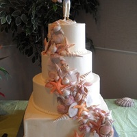 Seashell Wedding Cake Gumpaste seashells pressed from handmade silicone molds. First buttercream frosted wedding cake