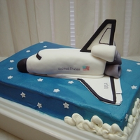 Space Shuttle The man retired from Nasa and worked on the Space shuttle. Cake is half chocolate and vanilla with buttercream icing. Space shuttle is made...