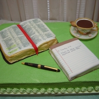 Quiet Time With The Lord. Everything is edible except the pages in the Bible, they are on transparency film. The cup, saucer, and ball point pen are gumpaste fondant...