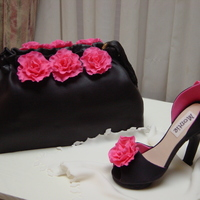 Purse And Heels White cake buttercream icing covered in fondant with gumpaste high heel.