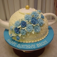 Tea Pot Birthday Cake is iced in buttercream. Flowers, spout, lid and handle are fondant gumpaste.