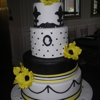 Sprintime In Paris Black and white fondant four tier cake for a gala charity event with yellow accents.